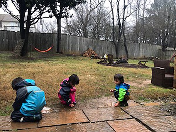 Kids playing outside in the rain