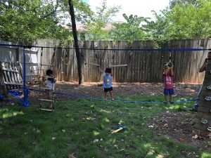 Screen free learning, outdoor based play and learning, kids playing on Ninja Slack line