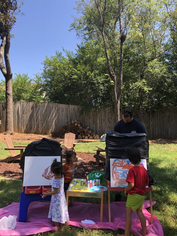 Screen free learning, outdoor based play and learning, painting outside