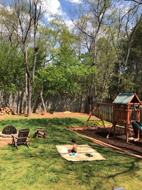 Screen free learning. outdoor play setup with picnic blanket