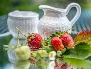 picture of strawberries with a pot of cream