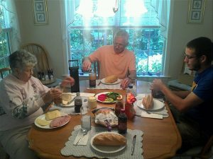 grandparents with family at dinner table