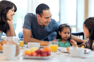 kids eating healthy meal with family