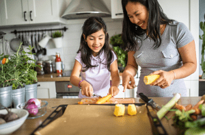 mom and daughter cooking a healthy meal