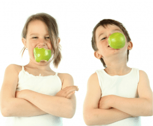two children enjoying fruit as a healthy snack