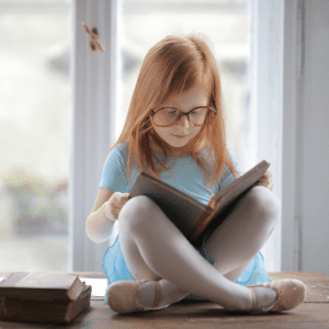 child reading in summer